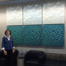 Eve inspects the installation of her Clouds and Zumscapes in the NYU Langone Medical Center Art Collection