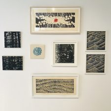 Wall of small woodcut prints (sizes variable)
